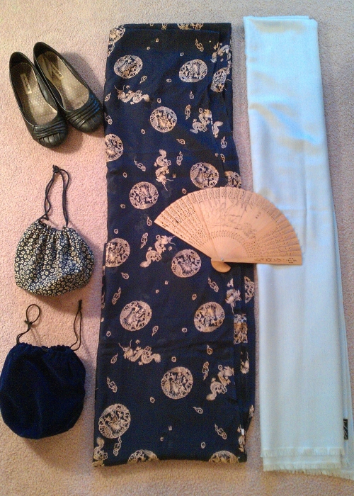 Step 10.  Accessorize with flat shoes, a shawl (long rectangle of coloured fabric like a long Pashmina, often of Indian silk), a reticule (a fabric purse with a draw string), a fan, and/or long gloves.